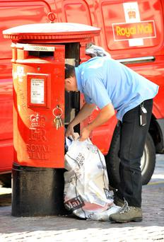 A Royal Mail post man