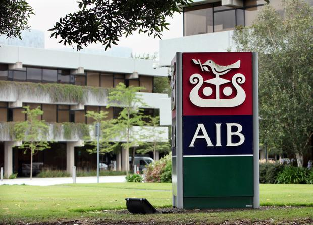 A sign stands at the headquarters of Allied Irish Banks Plc., (AIB) in Dublin, Ireland, on Monday, Aug. 17, 2009. Photographer: Crispin Rodwell/Bloomberg