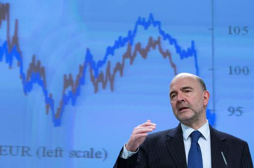 European Commissioner Pierre Moscovici presents the EU executive's spring economic forecasts in Brussels yesterday