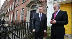 Már Guomundsson chats with the Governor of the Central Bank of Ireland, Patrick Honohan, during his visit to Dublin