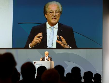 Holcim chairman Wolfgang Reitzle speaks to shareholders during their extraordinary shareholder meeting in Zurich yesterday