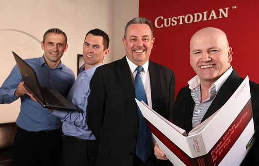PROTECTORS OF THE BRAND: From left, Alan Brogan, Ciaran Reilly and Bernard Lyons of Custodian with Sean Gallagher. Photo: Gerry Mooney