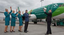 Chief executive Stephen Kavanagh with Aer Lingus cabin crew, from left, Sarah Nolan, Tracey Johannson, Gillian Kane & Ronan Hughes, at the unveiling of the first Aer Lingus aircraft in the IRFU Livery