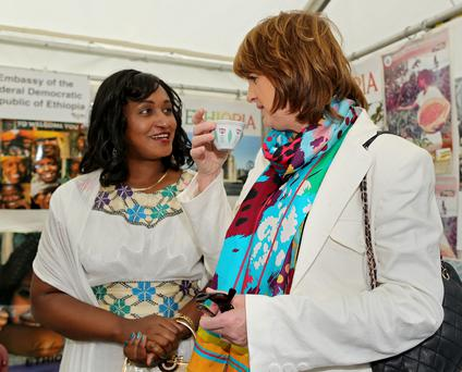 Tánaiste Joan Burton with Ethiopian ambassador Lela Alem at the Africa Day festival at Farmleigh Estate in Dublin