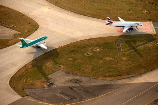 Aer Lingus and BA planes on the runway at Heathrow Airport