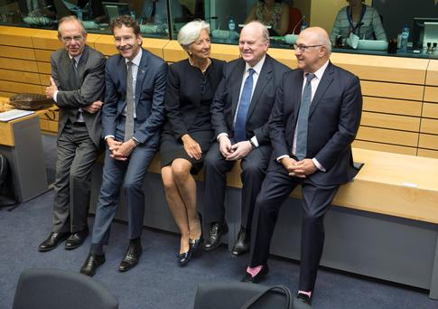 IMF managing director Christine Lagarde and Finance Minister Michael Noonan and French Finance Minister Michel Sapin at the meeting in Brussels