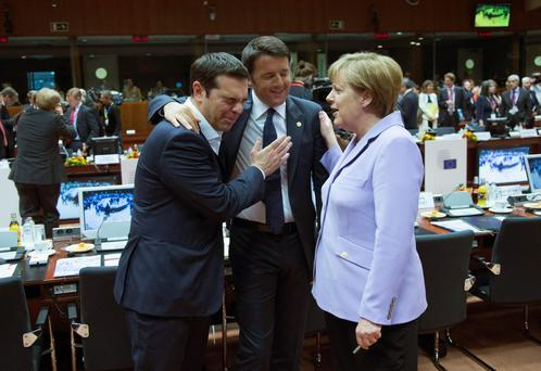 Greek Prime Minister Alexis Tsipras, Italian Prime Minister Matteo Renzi and German Chancellor Angela Merkel share a joke before getting down to negotiations at the EU leaders' summit in Brussels