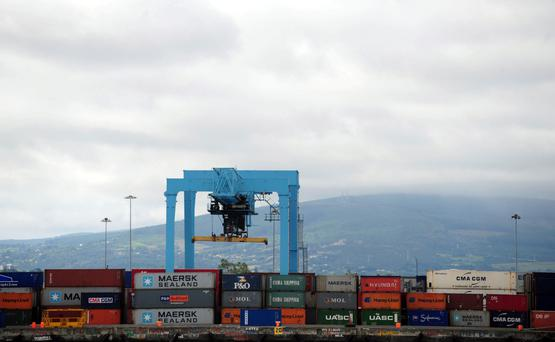 Shipping containers are stacked at Dublin port in Dublin