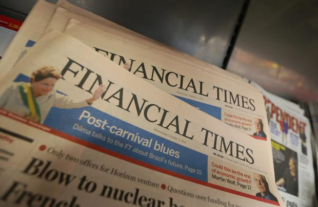 Copies of the Financial Times newspaper are seen on display at a newsagents in London. Photo: Bloomberg