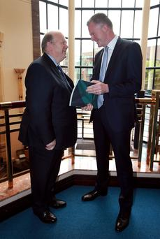 NTMA Chief Executive Conor O Kelly chats with Minister for Finance Michael Noonan, before the publication of the NTMA Annual Report for 2014 and mid year update for 2015 at the NTMA HQ in Dublin.