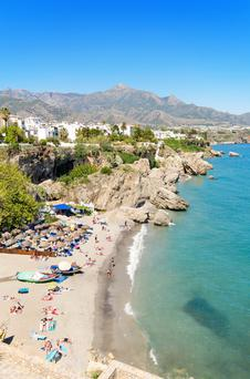 Sun, sea, sand: With 148 flights to Spain each week, Irish people are flocking to beaches like this one on the Costa Del Sol