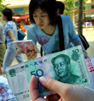In Asia, China's yuan devaluation is likely to remain a focus