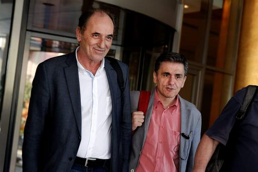 Greek Economy Minister George Stathakis, left, and Finance Minister Euclid Tsakalotos following an overnight meeting with representatives of the IMF, the European Commission, the ECB and the Eurozone's rescue fund in Athens