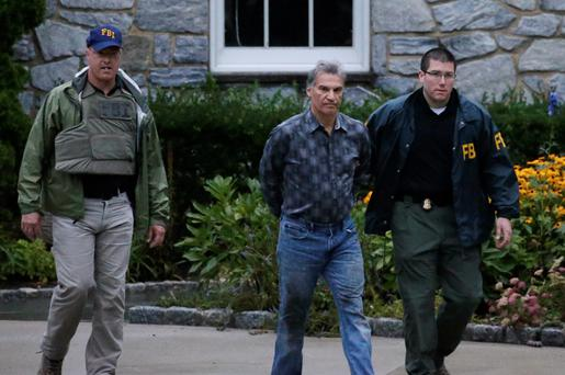Federal agents arrest a suspect, centre, in Pennsylvania yesterday
