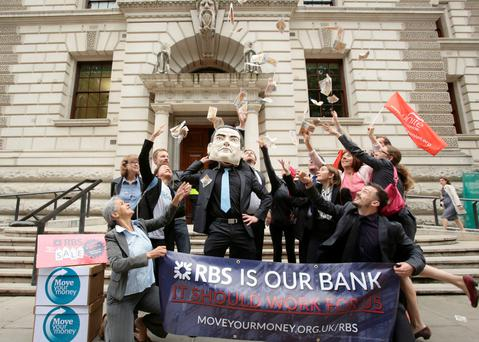 Britain's Chancellor George Osborne is the target of protester's ire at a protest against the UK government's RBS shares sell-off.