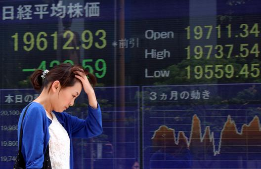 Markets from Tokyo (above) to Europe have been hammered amid global concerns over the state of the Chinese economy. Photo: Bloomberg