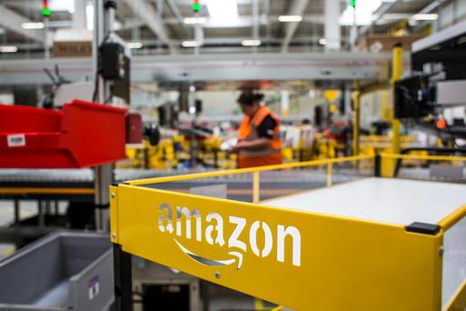 An empty cart stands in the distribution zone on the opening day of the new Amazon.Com Inc. fulfillment center in Dobroviz, Czech Republic, on Tuesday, Sept. 8, 2015. By the year 2018, 2,000 permanent and 3,000 seasonal workers will find a job at the warehouse which already now has 1,500 permanent employees. Photographer: Martin Divisek/Bloomberg