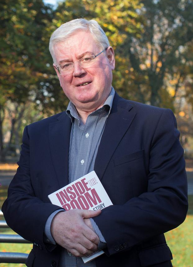 Former Tanaiste Eamon Gilmore with his new book. Photo: Fergal Phillips