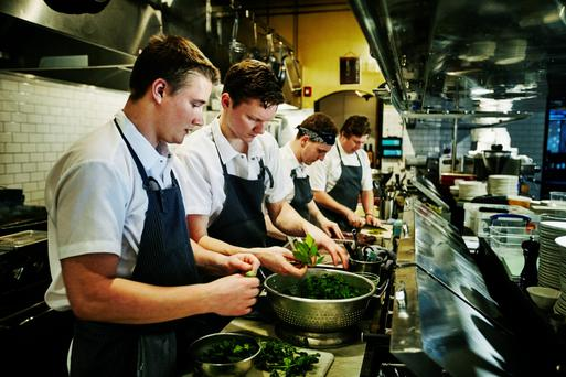 Chefs prep for dinner in a busy kitchen. Photo: Getty Images