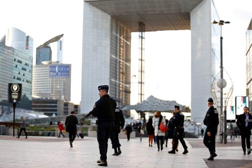 Armed police at La Defense, the main business district of Paris. Photo: Reuters