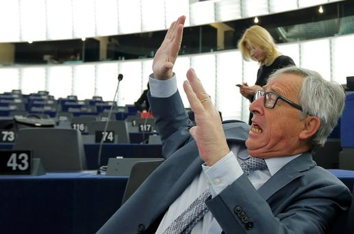 Commission President Jean-Claude Juncker jokes with a Member of the European Parliament ahead of a debate on the future of the Economic and Monetary Union at the European Parliament in Strasbourg. Photo: Reuters