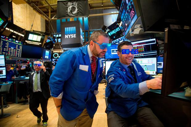 Traders work on the floor of the New York Stock Exchange in Manhattan on New Year's Eve as US stocks declined, with the Standard & Poor's 500 Index losing its grip on a fourth consecutive annual gain in the year's final trading session