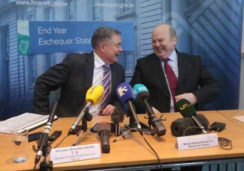 Finance Minister Michael Noonan and Public Expenditure and Reform Minister Brendan Howlin speaking to the press at the Department of Finance yesterday. Photo: Damien Eagers