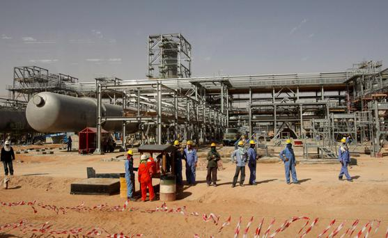 Workers at the Khurais oilfield about 160km from Riyadh
