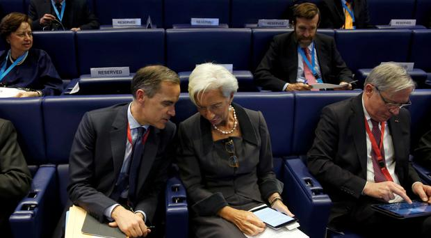 Bank of England governor Mark Carney and International Monetary Fund managing director Christine Lagarde chat at a Farewell Symposium on ultra low interest rates and challenges for central banks in Paris yesterday. Photo: Reuters