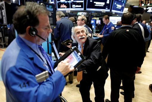 Traders work on the main trading floor of the New York Stock Exchange shortly after the opening bell of the trading session in New York. Photo: Reuters
