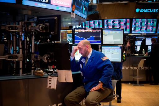A trader watches events at the New York Stock Exchange. Photo: Bloomberg