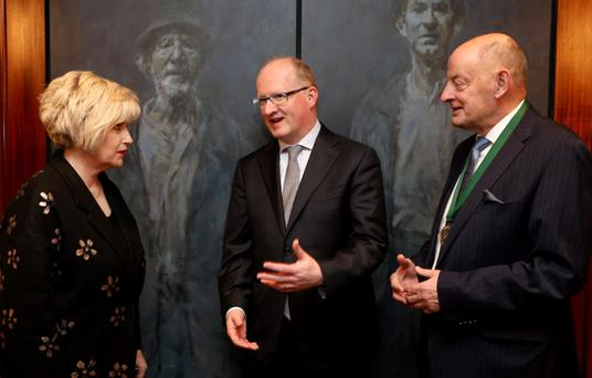 Governor Philip Lane, centre, with Institute of Directors chief executive Maura Quinn and president Des Lamont at the Institute's lunch in Dublin yesterday. Photo: Jason Clarke