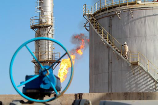 A worker climbs stairs at the Halfaya oilfield in Amara, southeast of Baghdad, January 21, 2016
