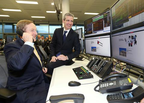 Enda Kenny with Tim O'Hara, Credit Suisse's CEO of Global Markets. Photos: Conor McCabe