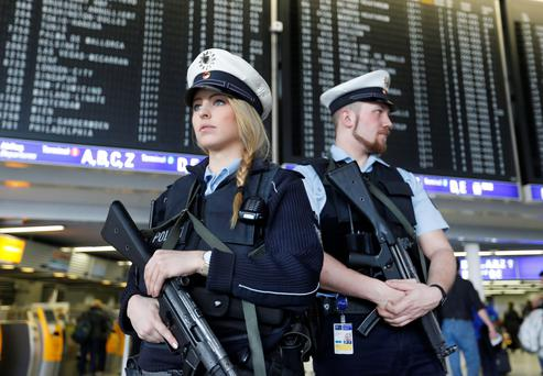 German police officers guard a terminal of the airport in Frankfurt, Germany. Photo: AP
