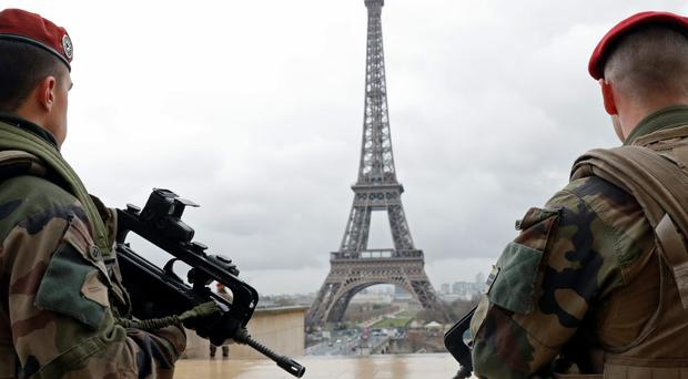 Paratroopers in Paris amid tighter security after Brussels attacks. Eurozone confidence had slipped even before latest atrocities. Photo: Reuters