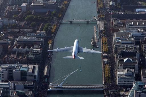 A British Airways A380 flies over Dublin's River Liffey during the FlightFest air show, backed by the IAA, in 2013