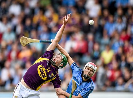 Conor McDonald (Wexford) in action against Cian O'Callaghan (Dublin) in the Bord Gais Energy Leinster GAA Hurling Under 21 Championship Final.
