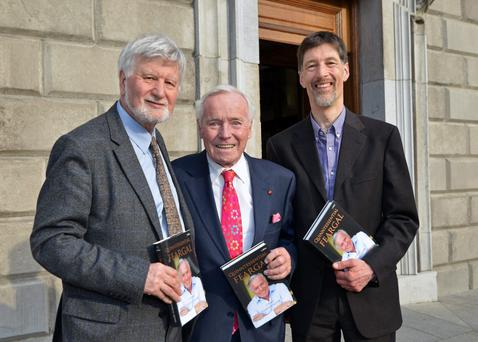 Michael, left, and Ivan O'Brien of the O'Brien Press with author and entrepreneur Feargal Quinn at the Leinster House launch