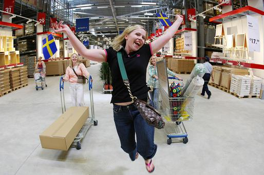 Flying the flag: Amanda Kelly from Dublin celebrates the opening of the IKEA store in Ballymun in 2009.