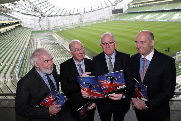 Foreign Affairs Minister Charlie Flanagan with IIEA director general Tom Arnold, IIEA chair Brendan Halligan and McCann Fitzgerald managing partner Barry Devereux at the Aviva Stadium. Photo: Maxwells
