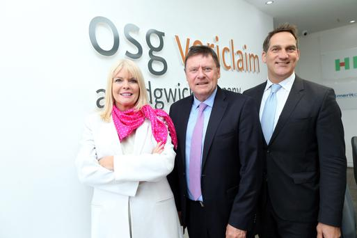 Minister for Jobs, Enterprise and Innovation Mary Mitchell O'Connor, Malcolm Hughes, chief executive of OSG Vericlaim, and Mike Arbour, division president, international accounts, Sedgwick, at yesterday's announcement. Photo: MaxwellsIreland