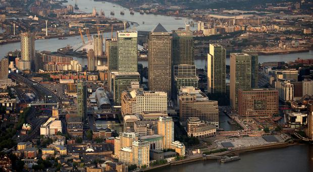 Skyscrapers in the Canary Wharf business, financial and shopping district, including HSBC Holdings Plc, center left, One Canada Square, center, and Citigroup Inc., are seen in this aerial photograph.