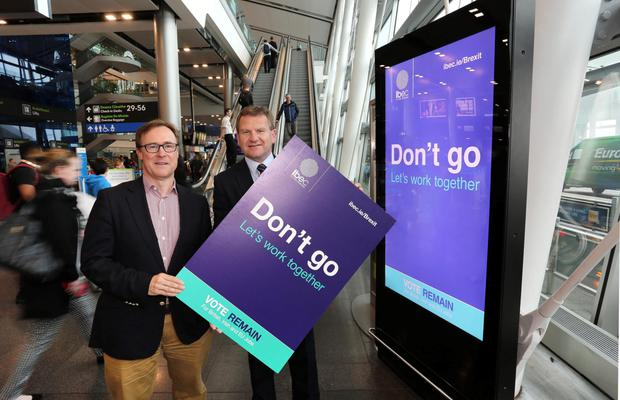 Kevin Toland, chief executive of the Dublin Airport Authority, and Danny McCoy, ceo of Ibec, launch the poster campaign. Photo: Gary O'Neill