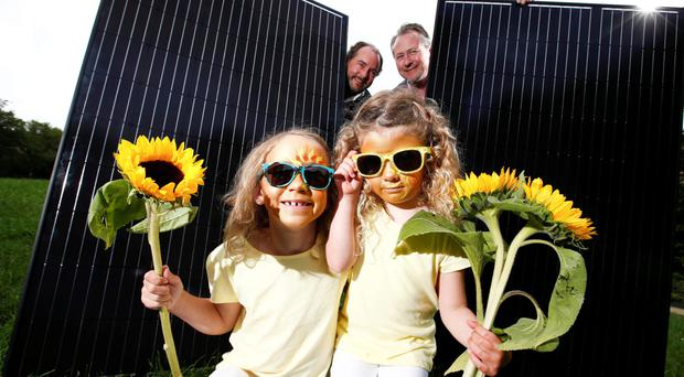 David Maguire, chairman of the Irish Solar Energy Association (ISEA), and ISEA member Peter Duff with Charlotte Maguire (7), from Dublin, and Ailbhe Kelly (4), from Cork, at the launch of the Irish Solar Energy Association's case for solar yesterday. Photo: Conor McCabe.