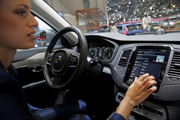 A Volvo employee tests out a new model. Volvo Ireland said there is an 'oversight' in financial regulation in Ireland from which some car manufacturers are benefiting.