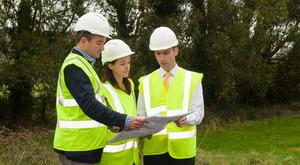 Thomas Pilz, managing partner, Pilz; Suzanne Kunschert, managing partner, Pilz; and Wesley O'Shea, automation manager, Pilz Ireland, discussing plans for the new site