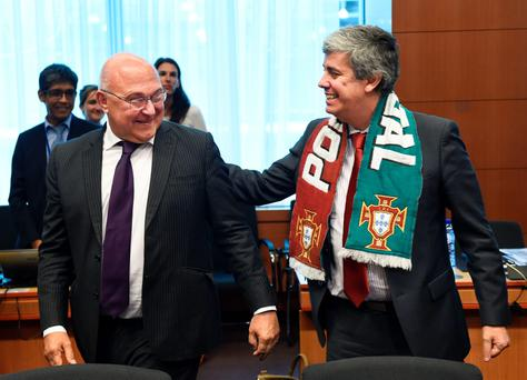Portugal's Finance Minister Mario Centeno with French counterpart Michel Sapin in Brussels yesterday