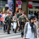 French soldiers, who are part of 'Operation Vigipirate', patrol near the streets near the Galeries Lafayette in Paris yesterday, a day after the attack in Nice in the south of the countryTha