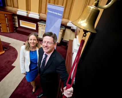 Brian Caulfield, Draper Esprit partner, rings the bell at the June IPO on the Irish Stock Exchange (ISE), watched by Orla O'Gorman, head of equity, ISE. Photo: Chris Bellew/Fennells
